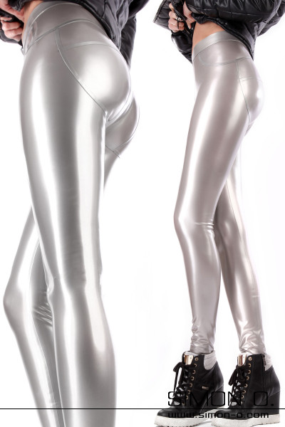 A woman wears a skintight shiny latex leggings in silver with High Heel Sneakers