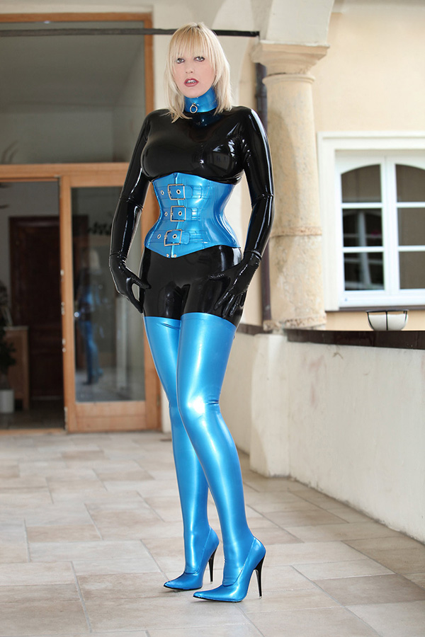 Tightly laced latex corset in blue with buckles in front