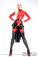 Preview: A woman wearing a latex catsuit in combination with a black latex train
