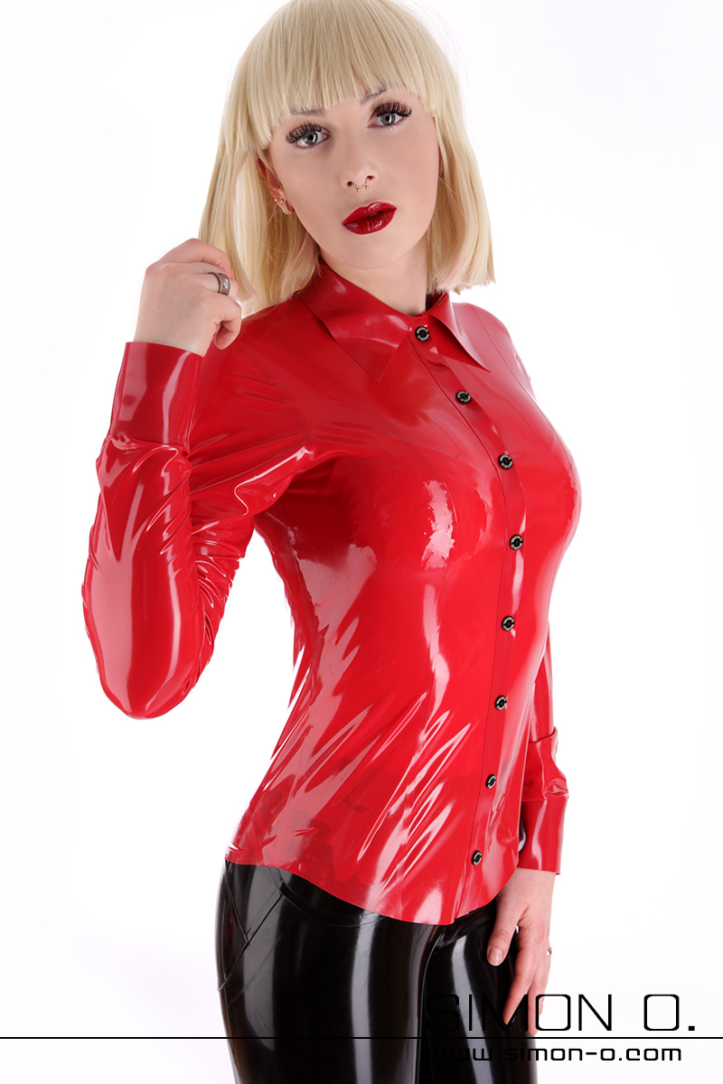 Elegant latex blouse with a button front and a lapel collar worn by a blonde girl with red lips