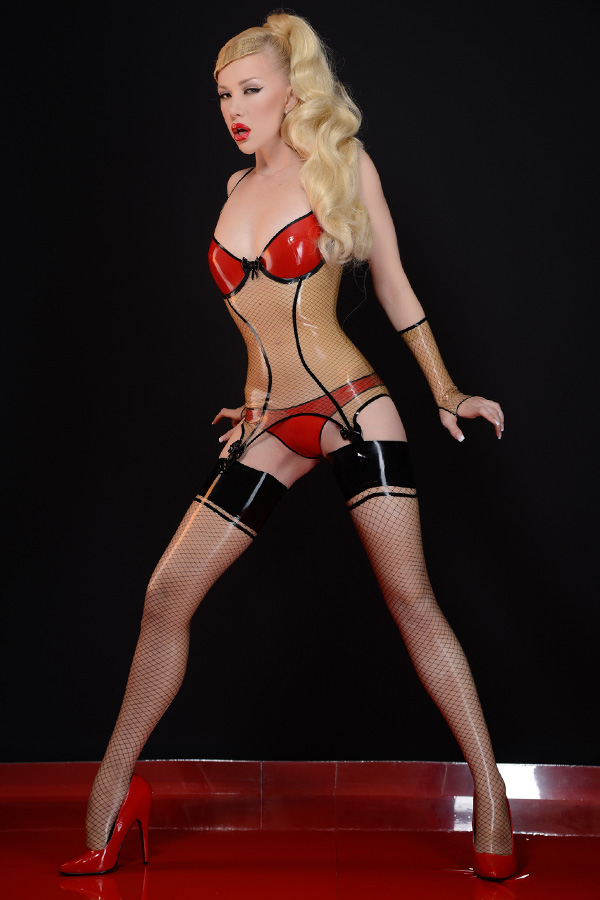 A woman wears latex lingerie and latex stockings in transparent with net pattern