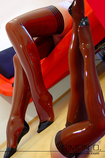 Latex Stockings with Garter Top in Stripe Design These latex stockings come with seams made of fine latex and special stripe design at the top for an alluring …