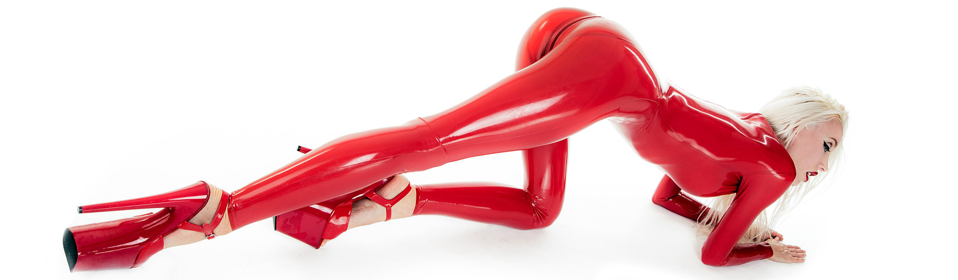 Skin tight red latex catsuit with glossy surface and zipper at crotch