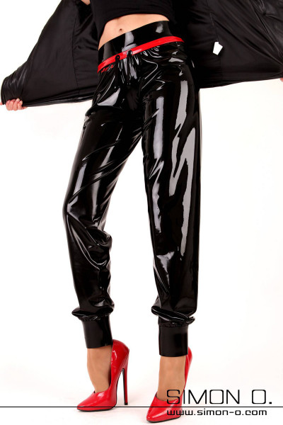 A woman wears a latex shiny sweatpants in black with red and red High Heels